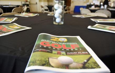 Programs from the George A. Pegues Memorial Family Self-Sufficiency Tourney. (Solomon Crenshaw Jr. / Alabama NewsCenter)