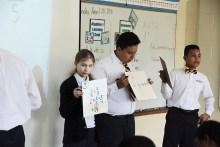 Students show their work to the rest of math class. (Karim Shamsi-Basha / Alabama NewsCenter)