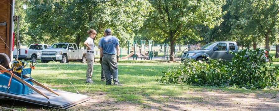Francesca Gross, left, urban conservation manager with The Nature Conservancy, talks with workers during last week's cleanup of the Village Creek area in East Lake Park. (Charlestan Helton/Alabama NewsCenter)