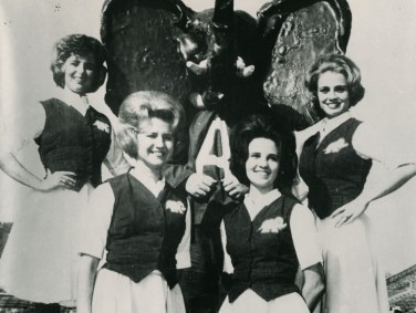 Cheerleaders and Melford Epsey, Jr. as an elephant mascot. (Paul W. Bryant Museum / The University of Alabama)