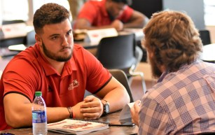 Tyler Scozzaro speaks with a member of the media during a preseason press event. (Solomon Crenshaw Jr./Alabama NewsCenter)