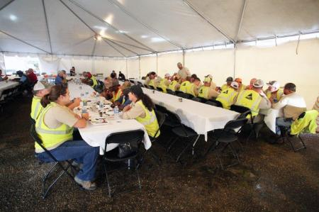 Alabama Power employees eat dinner at a staging area for Tropical Storm Gordon established at Mobile Greyhound Park in Theodore. (Mike Kittrell / Alabama NewsCenter)