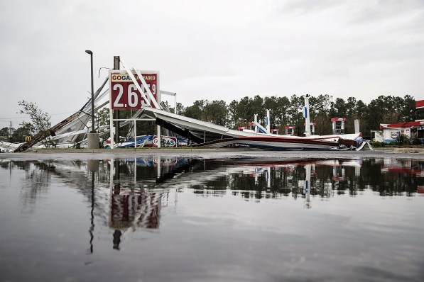 A damaged gas station is reflected in a puddle after Hurricane Florence hit in Wilmington, North Carolina. (Alex Wroblewski/Bloomberg)
