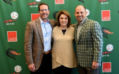 Tracey Thomas, whose late son, Jackson, will be honored by the UAB Blazers next month, is flanked by Children's Harbor CEO Myrle Grate and UAB Head Football Coach Bill Clark. (contributed)