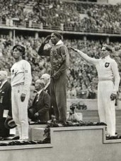 """Naoto Tajima, left, Jesse Owens, center, and Carl Ludwig """"Lutz"""" Long, right, won the bronze, gold and silver medals, respectively, in the long jump event at the 1936 Olympics in Berlin, Germany. Long reportedly helped Owens with advice in the event after the American fouled twice during a qualifying round, a courageous gesture of sportsmanship in 1930s Nazi Germany. (From Encyclopedia of Alabama, courtesy of Library of Congress)"""