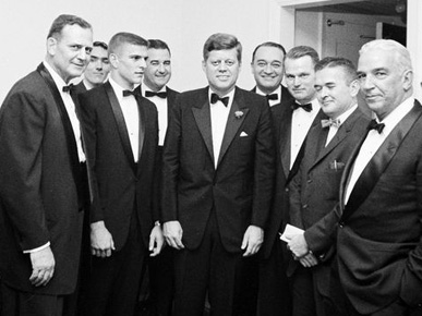 "U.S. President John F. Kennedy, center, poses with, from left, University of Alabama (UA) football coach Paul ""Bear"" Bryant, White House Army Signal Agency John J. Cochran, All-American UA quarterback Pat Trammell, UA President Frank Rose, sportscaster Mel Allen, UA sports Hall of Famer Young Boozer Jr., Birmingham News sports writer Benny Marshall, and Alabama businessman Tom Russell at the Waldorf Astoria Hotel in New York City in December 1961. (From Encyclopedia of Alabama, courtesy of the John F. Kennedy Presidential Library and Museum)"