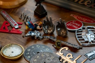 Jason Burnett scours junkyards, flea markets and eBay to find materials for his clocks. (Mark Sandlin/Alabama NewsCenter)