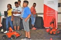 Students at the Energy Awareness Fair experiment with robots. (Dennis Washington/Alabama NewsCenter)