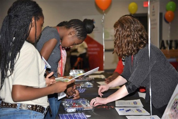 Birmingham middle school students get information on various energy and technology-related careers at the AABE Energy Awareness Fair. (Dennis Washington/Alabama NewsCenter)
