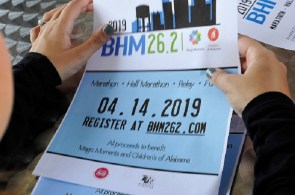 Anna Martin holds materials for next year's BHM26.2 races. (Karim Shamsi-Basha/Alabama NewsCenter)