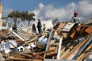 Members of Florida Task Force Two Search and Rescue continue their work of searching the area after Hurricane Michael passed through on October 15, 2018, in Mexico Beach, Florida. (Joe Raedle/Getty Images)