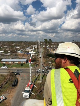 An Alabama Power worker surveys the damage caused by Hurricane Michael in Florida. (M. Walker Hutchens)