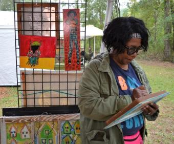 Robinson says she never knows what she's going to paint until she gets started, but she knows that somehow it will come from her family. (Michael Tomberlin/Alabama NewsCenter)