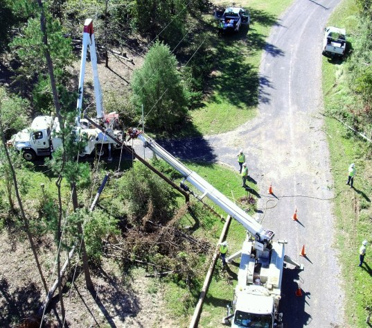 An Alabama Power line crew works to make repairs after Hurricane Michael. (Allen Whisenant / Alabama NewsCenter)