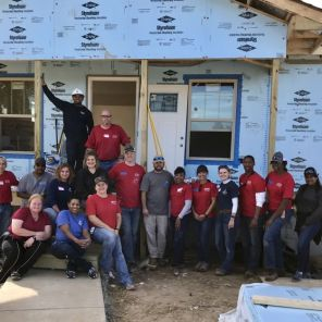 Teamwork and coordination help the build of this 24th Habitat home by APSO work smoothly. (Michael Sznajderman)
