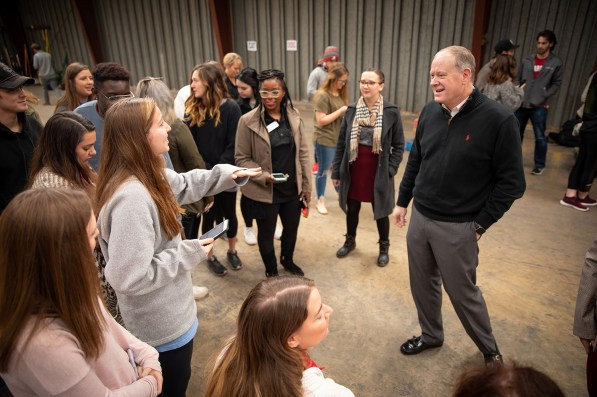 University of Alabama students celebrate the end of the Beat Auburn, Beat Hunger food drive with Dr. David Grady, vice president, student life. (University of Alabama)