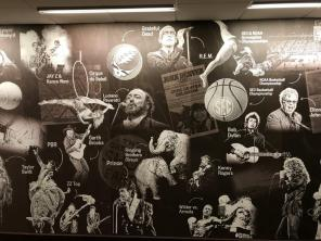 A mural inside the BJCC offices shows just a few of the artists and events the BJCC has hosted in the past 42 years. (Michael Tomberlin / Alabama NewsCenter)
