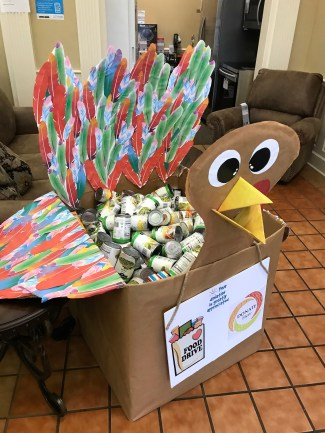 "Customers handed in food donations in the Alabama Power business office, using this creative storage ""turkey"" by Joni Hubbard. (Brooke Goff)"