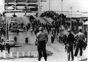 Alabama officers await demonstrators at the Edmund Pettus Bridge. (U.S. Department of Justice, Wikipedia)