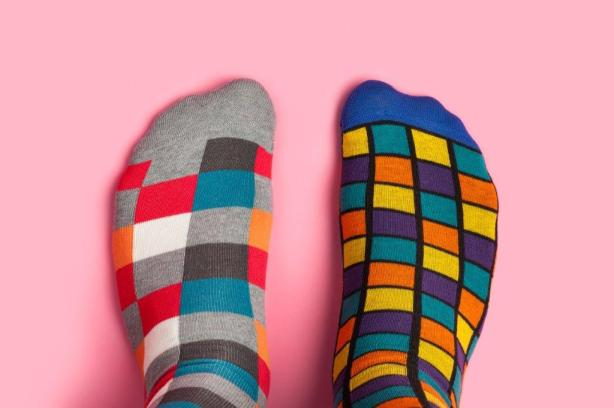 Wearing socks around the house can help you feel warmer all over. (Getty Images)