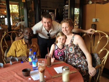 The Laslo family with Yeko, an African artisan whose work can be found in the Laslos' Homewood shop. (contributed)