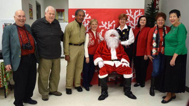 Mobile Energizer 'elves' bring Christmas to Southwest Regional School for the Deaf and Blind