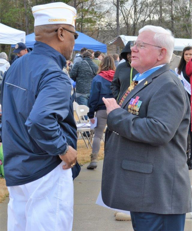 Medal of Honor recipient Capt. Gary Michael Rose, right, meets with attendees at the Wreaths Across America ceremony at the Alabama National Cemetery. (Michael Tomberlin / Alabama NewsCenter)