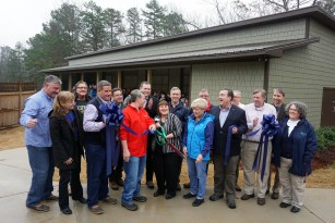 Dec. 15 ribbon-cutting ceremony for the new mew and education ambassadors at the Alabama Wildlife Center. (Erin Harney / Alabama NewsCenter)