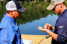 Biologists Chad Fitch and Jason Carlee count snails as part of an environmental operation on Lay and Mitchell lakes. (Justin Averette/Shorelines)