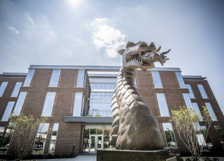 The 8-foot bronze 'Blaze' statue, designed and created by Branko Medenica and donated by Ken Jackson, is the centerpiece for Blazer Pride Plaza and the main entrance to the Collat School of Business. (Adam Pope/UAB)