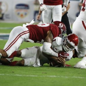 Christian Miller making a tackle during bowl game. (Robert Sutton)