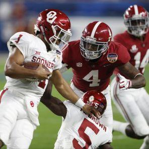 Alabama defensive back Saivion Smith (4) has Oklahoma quarterback within grasp. (Amelia J. Brackin)