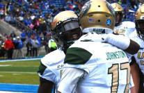 Tyler Johnston gets a hug after scoring a first-half touchdown. (Solomon Crenshaw Jr. / Alabama NewsCenter)