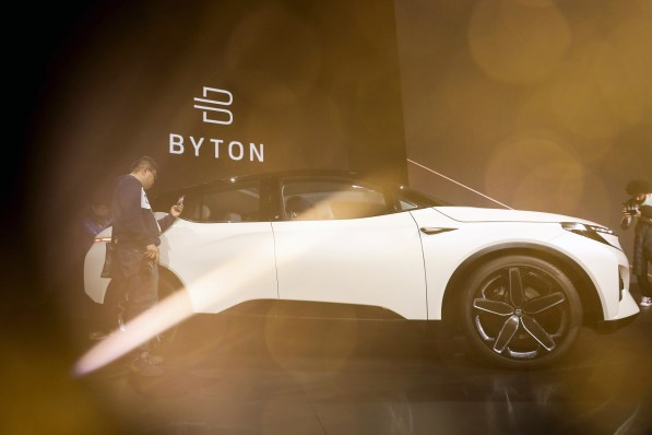 Attendees take pictures of the M-Byte concept electric SUV during the Byton event. (Patrick T. Fallon/Bloomberg)