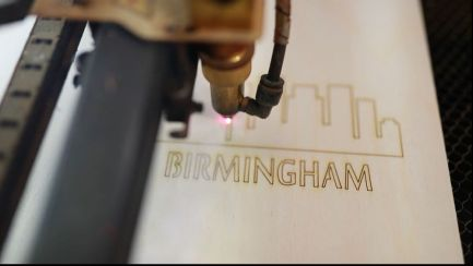 "A custom ""Birmingham"" wood notebook comes together with high heat from the laser cutter. (Joe Allen)"