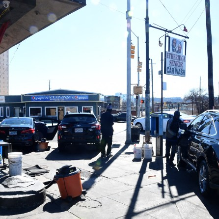 Cars are washed at the Etheridge Senior Showroom Car Wash Detail in the 4th Avenue District. (Mark Almond)