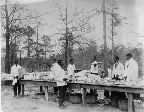 African-American men preparing to serve a meal in an outdoor setting among trees, c. 1890 to 1910. (Library of Congress, Prints and Photographs Division)