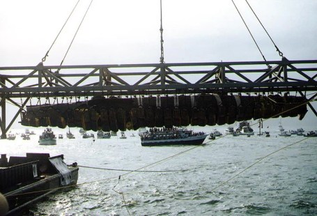 Confederate submarine H. L. Hunley, suspended from a crane during recovery from Charleston Harbor, Aug. 8, 2000. (Barbara Vougaris, Naval Historical Center, Wikipedia)