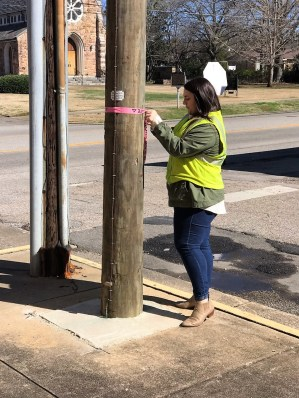 Distribution engineer Jodi Franklin flags a utility pole on the job for Alabama Power. (contributed)