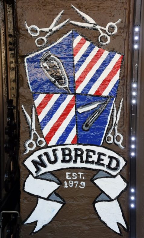 The logo for the Nubreed Barber Shop is show at the 4th Avenue District. (Mark Almond)