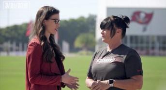 Tampa Bay Bucanneers team reporter Casey Phillips interviews Lori Locust, new assistant defensive line coach of the NFL Bucs. (Buccaneers.com)