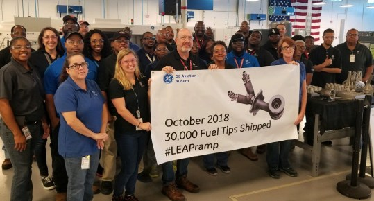 GE Aviation's manufacturing plant in Auburn celebrates its 30,000th 3D-printed fuel nozzle tip for the LEAP engine. (GE Aviation)