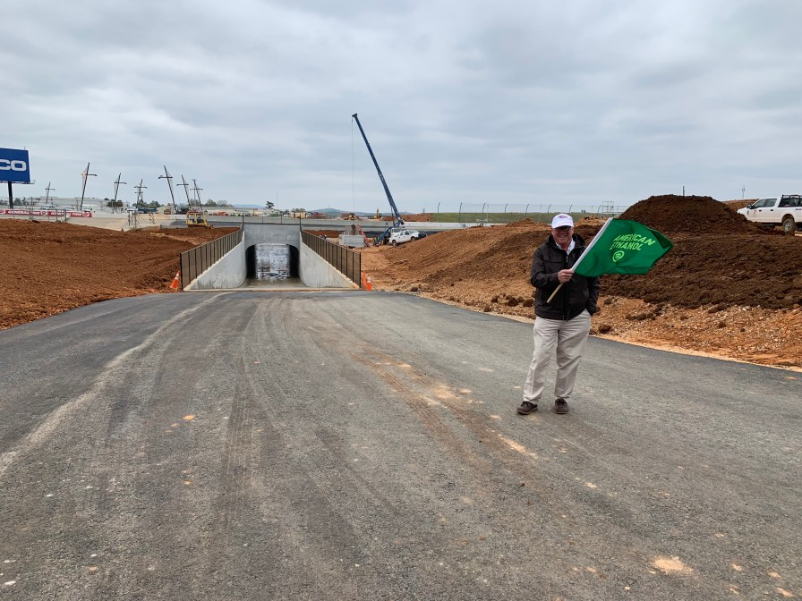 Talladega Superspeedway Chairman Grant Lynch holds a green flag moments before opening the new oversized vehicle tunnel at the track. (Dennis Washington / Alabama NewsCenter)