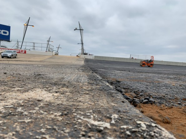 Paving continues in turn three above the new oversized vehicle tunnel at Talladega Superspeedway. (Dennis Washington / Alabama NewsCenter)