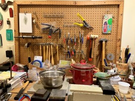 Anne Moore's workspace reveals the variety of tools she uses to craft her pieces of jewelry. (Brittany Faush / Alabama NewsCenter)