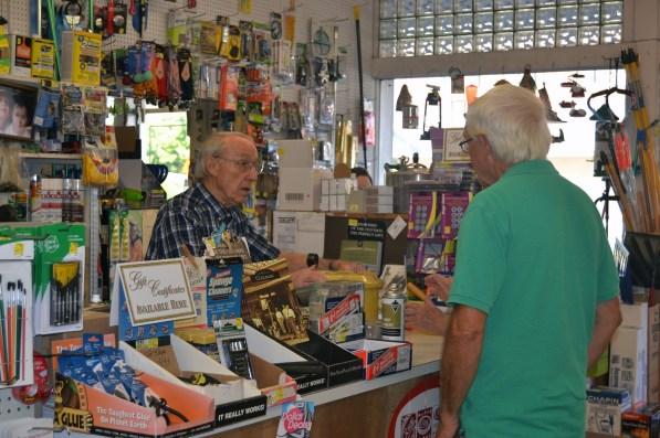Raymond Young waits on a customer at Mary Carter Store. (Melissa Johnson Warnke/Alabama Retail Association)
