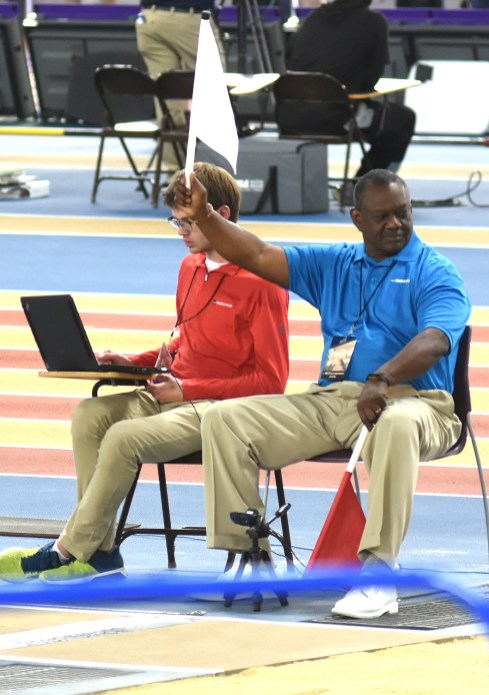 An official signals a successful effort in the long jump. (Solomon Crenshaw Jr./Alabama NewsCenter)
