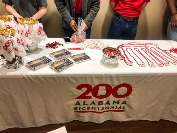 A table setup displays items commemorating Alabama's bicentennial. (contributed)