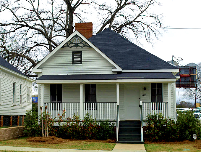 """Famed singer, composer, and musician Nat """"King"""" Cole was born in this home in Montgomery, Montgomery County, on March 17, 1919. In 2000, the home was relocated to the campus of Alabama State University, also in Montgomery, and is undergoing restorations. (From Encyclopedia of Alabama, Alabama State University)"""