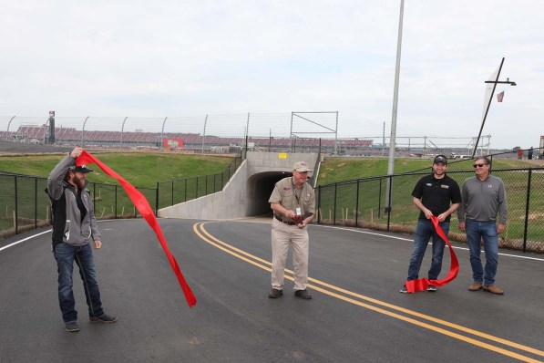 """NASCAR drivers Jeffrey Earnhardt (left) and Chase Briscoe (second from right) joined Talladega Superspeedway Chairman Grant Lynch (center), and Lance Taylor (far right) from Taylor Corporation, who spearheaded the tunnel construction efforts, in the ribbon-cutting ceremony on Wednesday as part of the """"official"""" Grand Opening for fans to enter the track's iconic infield. (contributed)"""
